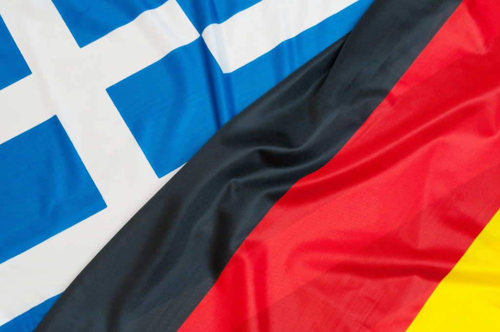 Close up of flags of Germany and Greece